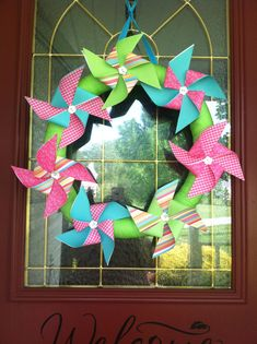 Summer pinwheel wreath made with pool noodle and scrapbook paper