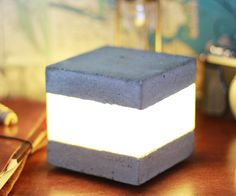 This concrete LED light cube is very simply, yet pretty striking and I think it would make the perfect accent or night light. Concrete is so much fun to use, and of course you can vary the design depending on your preferences and add color, change the size of the molds - whatever. It's a pretty easy project and you don't need too many tools to work on it!