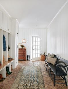 Warm and wonderful mudroom with white vertical shiplap wall treatment, brick herringbone flooring, built in cabinets and cubbies, black bench, and vintage Turkish runner - Amber Interior Design Home, First Home, Cheap Home Decor, Brick Flooring, Home Remodeling, Interior, House, Amber Interiors, House Interior