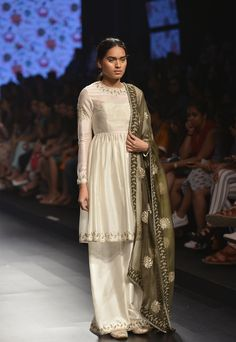 PAYAL SINGHAL Ivory short pleated kurta with ivory palazzo pants and green embroidered dupatta available only at Pernia's Pop Up Shop.