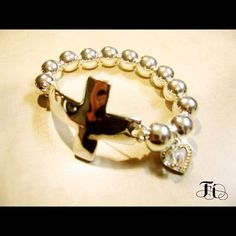 High polished Hammered Cross Bracelet Hammered cross bracelet with all silver beads and heart and drop clear crystal bead. Fi Jewelry Bracelets