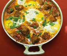 kefta, tomato & egg tagine w/ ground beef/lamb, red onion, cumin, paprika, coriander, ginger root, cilantro, olive oil, eggs, onion, garlic, parsley, tomatoes & cinnamon