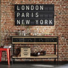Discover Maisons du Monde's Solid Mango Wood and Black Metal Industrial Console Table. Browse a varied range of stylish affordable furniture to add a unique touch to your home. Design Industrial, Vintage Industrial Decor, Industrial Living, Industrial Interiors, Industrial Style, Industrial Door, Industrial Office, Industrial Artwork, Industrial Bookshelf