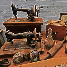 Wonderful vintage machines... - my mom made my clothes on the old treadle machine, then grandma got a motorized Singer for mom from the hospital where she mended linens - so much faster!