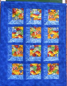Tropical Fish quilt available for sale on etsy. Cot quilt, single bed topper, child's quilt.