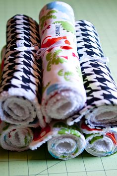 First you need to pick your fabric. You need about 1/2 yard of each kind that you want and you can get about 4 burp clothes out of the 1/2 yard when you cut them at 16 inches by 10 inches.  Supplies  *1/2 fabric for each pattern you want. I used flannel & cotton.  *1/2 terry cloth for each pattern you choose. OR buy a towel from target in coordinating color and cut to size (don't use  binding)  *coordinating thread