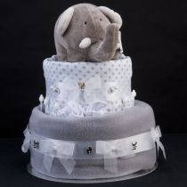 Ingredients • 31 Pampers size 3 Nappies • Babysoft Pram/Crib Blanket • 1 100% Cotton Muslin Square • 1 Pair Cotton Scratch Mitts • 1 Elli Elephant soft toy from the Elli & Raff Collection • Finished off with Satin Ribbon, Organza Bows and 'Baby' Embellishments AND • 1 mini bath bomb for Mummy
