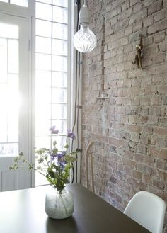 Brick wall.  Light fixture.  Vase. Light.  A Swedish Kitchen via Lovely Life I Remodelista