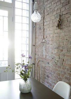 Brick wall.  Light fixture.  Vase. Light.  A Swedish Kitchen via Lovely Life I Remodelista