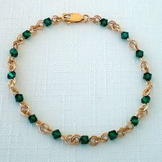 May Birthstone Bracelet- Emerald is the birthstone for the month of May. Emeralds were once used for physical and emotional healing and were believed to improve memory and intelligence. This bracelet is hand-made with 14kt gold fill and Swarovski® crystal. A great gift for birthdays, graduations, Mother's Day, wedding parties and bridesmaids, and other special occasions. Approximately 7 inches in length. $25.00