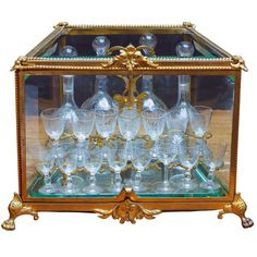 French Tantalus Drinks Set of Gilt Bronze | From a unique collection of antique and modern barware at http://www.1stdibs.com/furniture/dining-entertaining/barware/