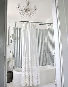 white bathroom. love the chandelier!