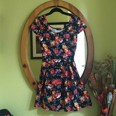 "Floral Print Fit & Flare Cap Sleeve Mini Dress New never worn, missing tag, perfect condition. ""Rag Therapy"" brand, made in USA. Polyester. Knit fabric, bold floral printed, cap sleeve, scoop neck, comes with a belt. 34"" length, 32"" waist. Fits between Medium-Large. Rag Therapy Dresses Mini"