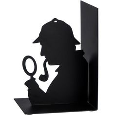 A slim black steel bookend featuring the iconic silhouette of Baker Street's most famous detective. One steel bookend. Nine Cat, Famous Detectives, Literary Gifts, Singing In The Rain, Cat Silhouette, Cat Mug, Baker Street, Metallica, Bookends