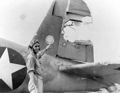 An amazing save: Lt Jimmy Johnson, USMC, points to the damaged rudder of his F4U Corsair fighter bomber after an encounter with the Japanese over the Russel Islands. Johnson succeeded in retaining control of his aircraft despite the absence of a rudder and bringing her in for a forced landing with no further damage. 1943.