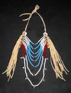 Crow style loop necklace   Pony beads & métal beads , sleigh bells  , abalones shell & deer skin fringes , antique brass nails ......  Collier loop style Crow  Perles de rocaille 'pony', perles en métal , grelots métal, franges en peau de cerf , clous antique