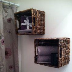 My first pinterest craft....Bathroom basket wall decor.