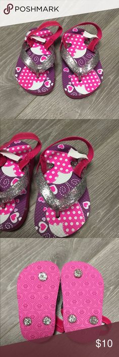 NWOT toddler Sandals Brand new and never worn! Baby girl sandals. Have strap to keep them on. Cute heart design. Size 4 to 5 Shoes Sandals & Flip Flops