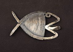 "Calder: Fish brooch, c. 1940  Silver and steel wire  3 3/8"" x 5 3/8""  Calder Foundation, New York"