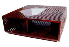 Ari Cocktail Table on OneKingsLane.com     A cognac finish on wood slats gives warmth to this four-foot-wide table. An off-center pane of glass is inset into the top. Two of the sides are open, allowing you to store books, games, and objets beneath the tabletop.