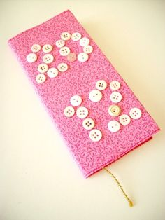 A customised button diary/notebook - tutorial here: http://www.helenlimbrick.com/2012/01/button-diary.html
