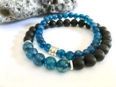 Denim blue dragon's vein agate with onyx stone. Handmade. https://www.etsy.com/listing/497269706/mens-bead-bracelet-black-bracelet-onyx?ref=shop_home_active_29&utm_content=bufferf168d&utm_medium=social&utm_source=pinterest.com&utm_campaign=buffer #etsymntt #Bracelet #jewelry