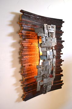 Functional Art. Light made entirely from recycled wine barrel staves and rings.