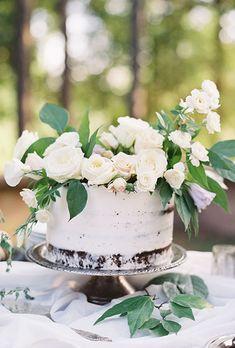 A gorgeous, rustic wedding cake by @earthandsugar | Brides.com