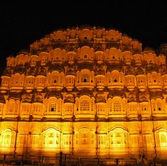 """Hawa Mahal (Palace of Winds), Jaipur, Rajasthan, India.   It was built in 1799 by Maharaja Sawai Pratap Singh, in the form of the crown of Krishna, the Hindu god. Its unique five-storey exterior is also akin to the honeycomb of the beehive with its 953 small windows that are decorated with intricate lattice work. The original intention of the lattice was to allow royal ladies to observe everyday life in the street below without being seen, since they had to observe strict """"purdah""""."""