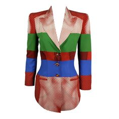 Jean Paul Gaultier 'Body Illusion' graphic blazer | France, 1980's-1990's | This piece is color blocked with a subtle op-art illusion design that, when looked at from afar, is a nude body. An incredible example of Gaultier's ability to balance creative expression with body-con silhouettes. Accented with marbelized multi-color buttons