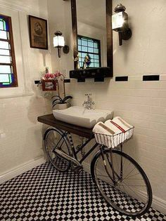 Paris themed bathroom decor with a lovely bicycle as the sink stand