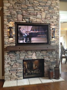 Love this fireplace. Stone + simple mantle.