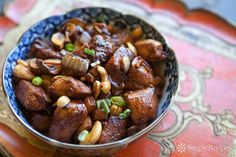 Marc's Cashew Chicken ~ Chicken marinated in peanut oil chili powder, tamari, and honey, then fried with cashews, onions, and mushrooms.  Served over rice. ~ SimplyRecipes.com