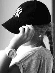 baseball cap + pearls + slouchy tee