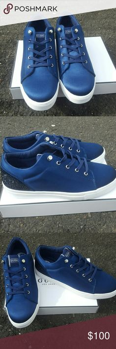 GUESS NAVY BLUE SNEAKERS GORGEOUS BRAND NEW GUESS SNEAKERS WITH RINESTONES ON THE BACK. (check pictures)  MATERIAL: SATIN COLOR: NAVY BLUE  BRAND NEW GUESS. 100%AUTHENTIC  ACCEPTING OFFER! Guess Shoes Sneakers