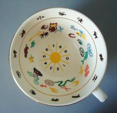 vintage Tea Leaf cup for reading what the leaves tell us.  Have you tried it?