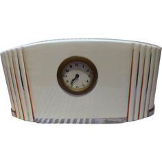 This fabulous French Clock is a classic piece of Art Deco Design from around the late 1920's to mid 1930's. The cream ceramic case  has vertical