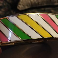 """Kate spade """"Make Believe"""" Bangle Kate Spade """"Make Believe"""" bangle. White/Pink/Green stripes on a gold bangle.  2 3/4 diameter Love this bangle.  Hate to part with it, but I need the money.  EUC kate spade Jewelry Bracelets"""