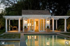HAMPTONS LIVING: The only thing I would change is to make the pool house bigger.  The pergola's at the side is gorgeous.