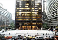 The Seagram Building is a skyscraper, located at 375 Park Avenue, between 52nd Street and 53rd Street in Midtown Manhattan, New York City. It was designed by Ludwig Mies van der Rohe, in collaboration with Philip Johnson. The building stands 516 feet tall with 38 stories, and was completed in 1958. It stands as one of the finest examples of the functionalist aesthetic and a masterpiece of corporate modernism.