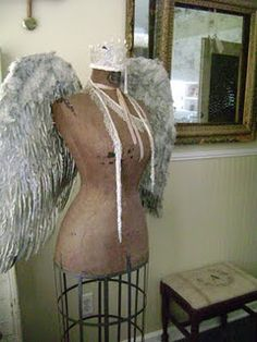 Vintage dress form with angel wings - this actually reminds me of an art project I did in high school...
