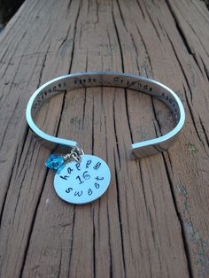 Hand Stamped Aluminum Cuff bracelet with charms.  Www.jewelrywithwords.etsy.com
