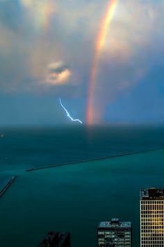 """Destruction"" and ""peace"" suddenly come to my mind. The lightning and rainbow seem to be all the way out in the distance judging by the scale the water is producing."