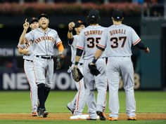 San Francisco Giants' Hunter Pence, left, celebrates with his team mates at the end of a baseball game against the Philadelphia Phillies on Monday, July 21, 2014, in Philadelphia. The Giants beat the Phillies 7-4. (AP Photo/Michael Perez)