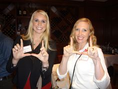 Eccles School alumni showing their Ute pride at our Houston Alumni Networking event.