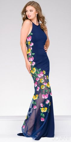 Take on the floral trend this season with the Jersey Floral Embroidered Halter Prom Dress. This fun yet elegant style features a halter neckline, a sleeveless bodice and a sultry open back with an invisible zipper down the center. The fitted silhouette includes jersey knit fabric with sheer sides and embellished floral embroidery with a short sweep train. #edressme