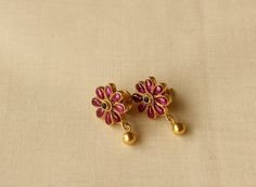 Gold Plated pure silver earrings in flower shape with emerald studded in the middle and a gold colour drop suspended at the bottom. Gold Jhumka Earrings, Gold Earrings Designs, Ruby Earrings, Gold Jewellery Design, Small Earrings, Gold Jewelry, Jewelery, Jewelry Necklaces, Handmade Jewellery