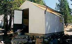 Example of tent cabin in Yosemite High Sierra Camp. You get two beds, wood stove, table and small bookcase that serves as dresser.