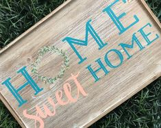 """This sign features a whitewashed background with blue and peach writing, complimented by the two tones wreath """"O"""". It has hanging hardware in the back side and it the perfect spring update for your home decor! Hand Painted Signs, Bamboo Cutting Board, Diy Home Decor, Sweet Home, Chalk Ideas, Etsy Seller, Couture, Unique Jewelry, Handmade Gifts"""