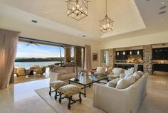 Transitional Living Room with Pendant light, Stone County Ironworks Ranch Coffee Table, Carpet, High ceiling
